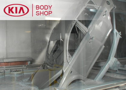 inside the body shop and collision center at Regal Kia